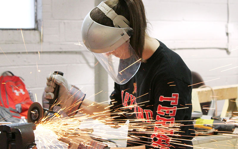 Female student welding