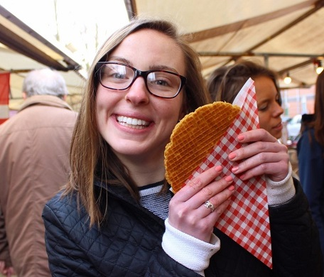 A Clark engineering student on study abroad enjoying local foods.