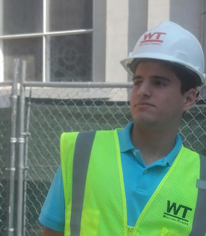 Mateus Coehlo wearing Whiting-Turner construction hat
