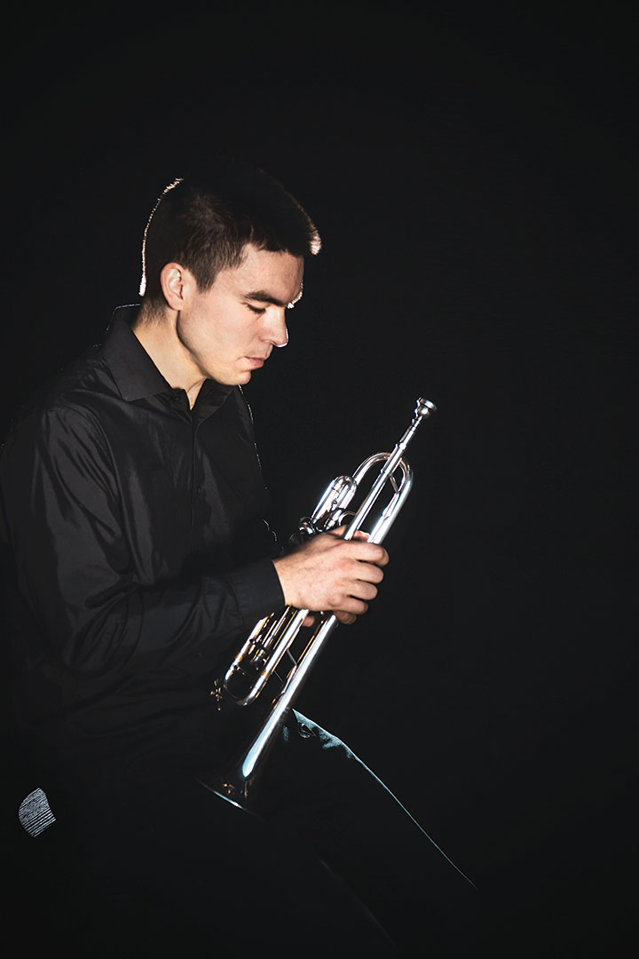 Student holds trumpet