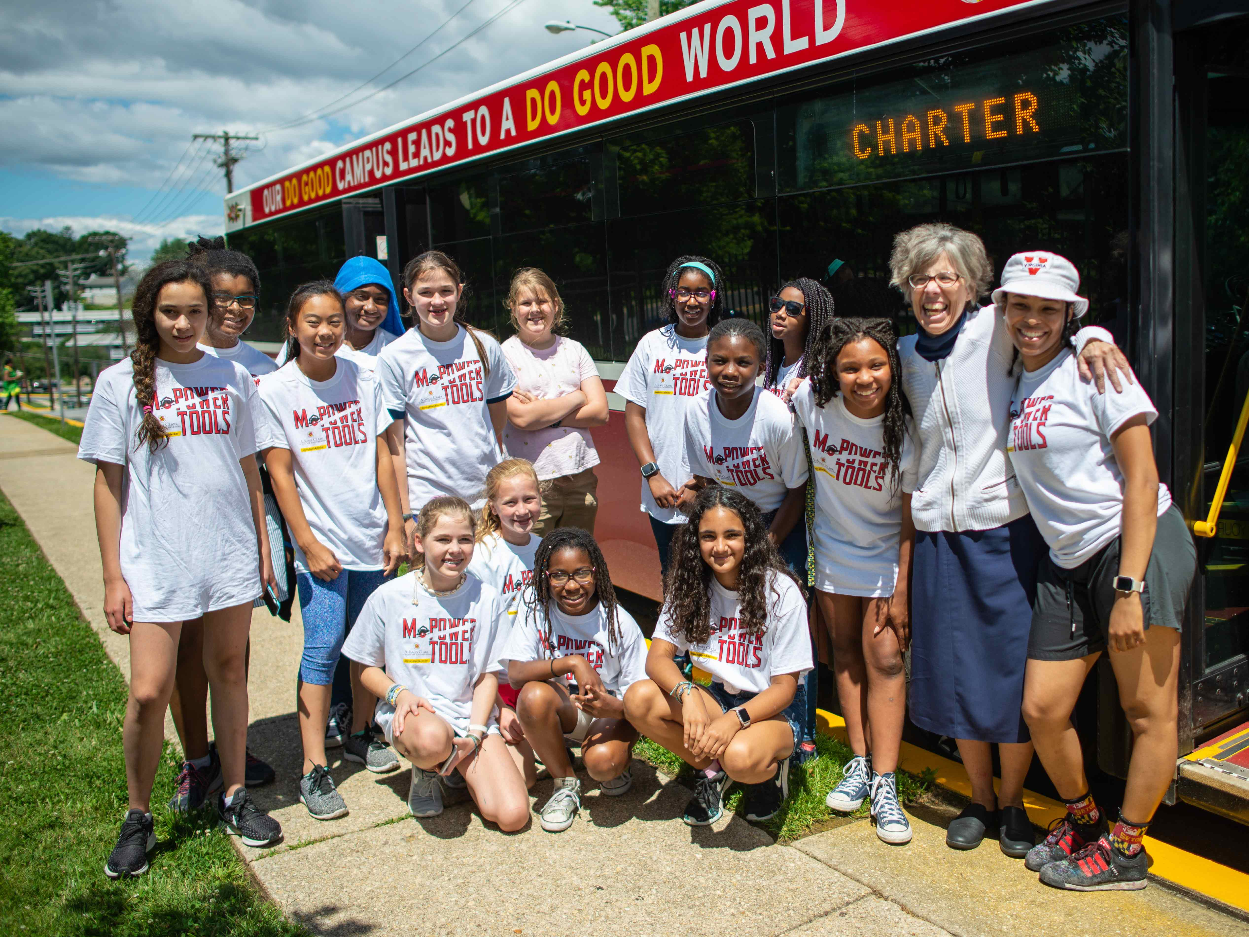WIE Power Tool camp group in front of UMD bus