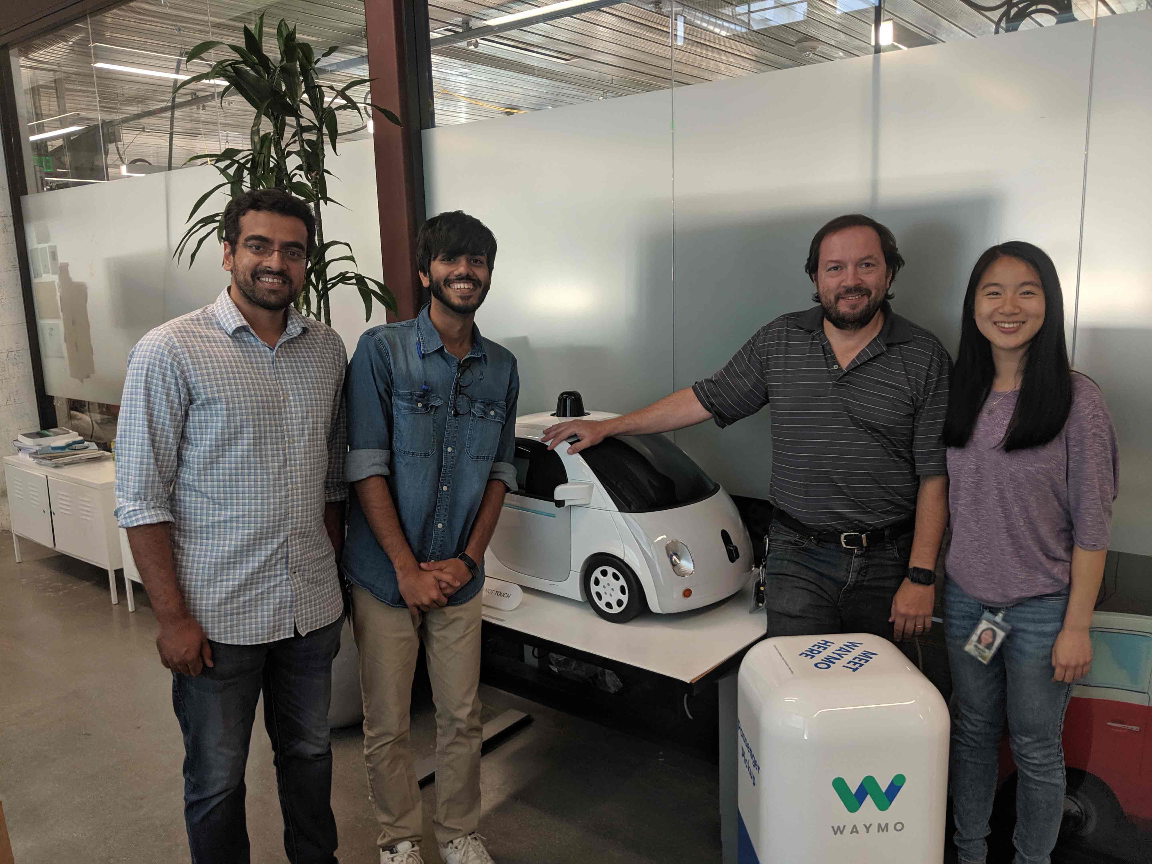 Yakeen Jain with colleagues and the Waymo Car