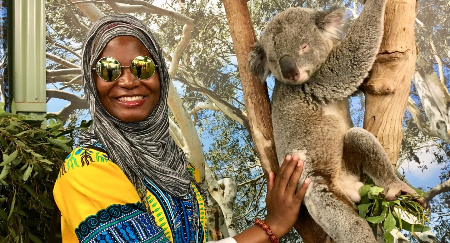 An A. James Clark School of Engineering student studying abroad and meeting a Koala Bear.